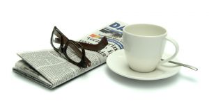 newspaper, glasses and cup